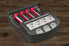 Smart AA AAA Battery Charger with batteries on the wooden backgr. Ound, 3D stock illustration