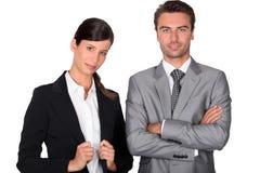smart affärsmanaffärskvinna Arkivfoton