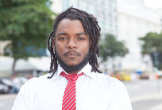 Smart african american businessman with dreadlocks in the city stock photography