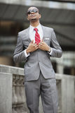 Smart African American young businessman wearing sunglasses Stock Images