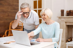Smart analytical elderly gentleman having a look at the data. What do you think. Vibrant ambitious intelligent women asking her husband for advice while studying Stock Photography