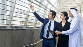 Smart asian arab business people man and woman worker talk. Smart asian arab business people men and women worker talk and joy together in the situation of look Stock Images