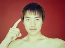 Smart asian boy portrait. The smart asian boy uses his head to his head, which means his brain is well developed Stock Images