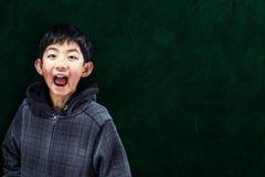 Smart Asian Boy at School Concept Stock Photos