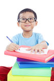 Smart Asian Boy Studying. Cute Asian boy with glasses studying shot in studio isolated on white Royalty Free Stock Photo