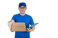 Smart Asian Chinese delivery guy in uniform delivering parcel. In isolated white background royalty free stock photography