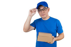 Smart Asian Chinese delivery guy in uniform delivering parcel Stock Image