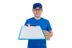 Smart Asian Chinese delivery guy in uniform delivering parcel Royalty Free Stock Image