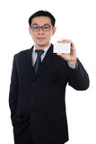 Smart Asian Chinese man wearing suit and holding blank card Stock Image