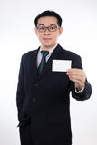 Smart Asian Chinese man wearing suit and holding blank card Stock Photography