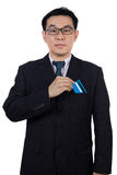 Smart Asian Chinese man wearing suit and holding credit card Royalty Free Stock Photography