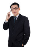 Smart Asian Chinese man wearing suit and holding mobile phone royalty free stock images