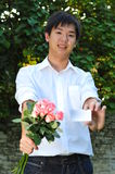 Smart Asian Man Holding A Bouquet Of Flowers Royalty Free Stock Photo