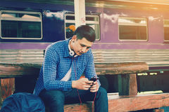 Smart asian man holding mobile phone and using app song for list stock photo