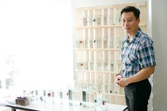 Smart asian men selling siamese fighting fish betta are welcom. Smart asian man selling siamese fighting fish betta are welcoming customers in the shop Stock Photography