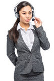 Smart Asian Woman Listening With Headset and Microphone Royalty Free Stock Photo