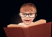 Smart Baby Reading Education Book on Isolated Background. A cute little baby is wearing eye glasses and reading a library book for an education or learning royalty free stock image