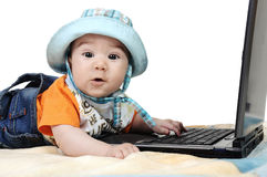 Smart baby is working on laptop Royalty Free Stock Photography