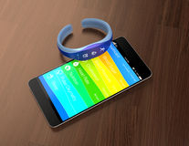 Smart band and smart phone on the table Stock Images