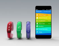 Smart bands and smart phone on gray background Royalty Free Stock Image