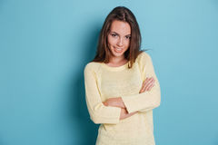 Smart beautiful girl standing arms crossed over blue background Stock Image