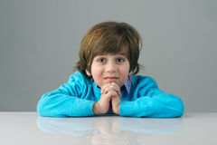 Smart beautiful kid thinking against grey background Stock Photos