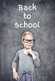 Smart beautiful little girl on the chalkboard background Stock Photo
