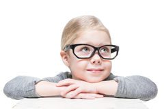 Smart beautiful little girl in glasses looking on something Royalty Free Stock Photos