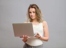 Smart beautiful young girl using laptop Stock Image