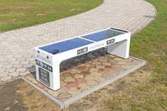 Smart Bench in the city park of a modern town of Tiszaujvaros in Hungary stock photos