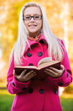 Smart blond woman with book Stock Photo
