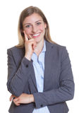Smart blonde businesswoman in a blazer Stock Image