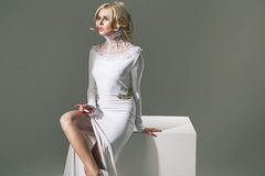 Smart blonde wearing an amazing gown Stock Photo