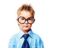Smart boy. Portrait of a serious little boy in spectacles and suit. Isolated over white background Stock Photos