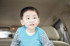 Smart boy in back of car Royalty Free Stock Photo