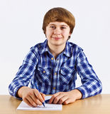 Smart boy doing his homework and learning for school Stock Photography