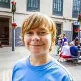 Smart boy enjoys walking in the village Stock Photography