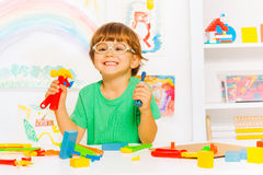 Smart boy in glasses with toy work tools Stock Photo