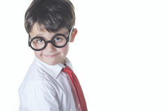 Smart boy. Happy boy with glasses and tie Royalty Free Stock Image