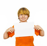 Smart boy holding a white sheet of paper Royalty Free Stock Photos