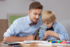 Smart boy learning through play Stock Photography