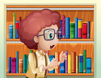A smart boy at the library Stock Image