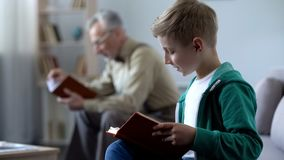 Smart boy and old man reading books, affordable education for different ages. Smart boy and old men reading books, affordable education for different ages, stock royalty free stock photos