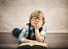 Smart boy reading a book Royalty Free Stock Images