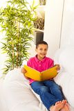 Smart boy reading Royalty Free Stock Photography