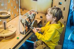 Smart boy scientist making physical experiments in the laboratory. Educational concept. Discovery.  stock photography