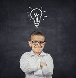 Smart boy with solution idea lightbulb above head Stock Photo