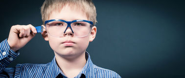Smart boy in virtual glasses with memory card. Royalty Free Stock Photos