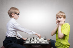 Smart boy vs stupid boy Stock Image