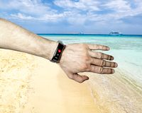 Smart bracelet on the athlete`s hand measures heart rate stock image